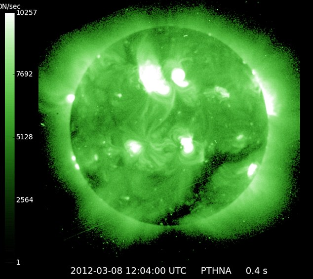 Largest solar flare in five years hits Earth… but 'jolt' predicted to disrupt flights, GPS systems and power grids fails to materialise