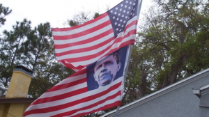 The Obama Flag: Who Decided That It Was Okay To Replace The Stars On The American Flag With The Face Of Barack Obama?