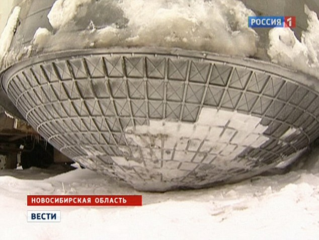 This really is space junk: Russian space experts examine 200-kilo metal 'UFO dustbin lid' which fell from the sky in Siberia