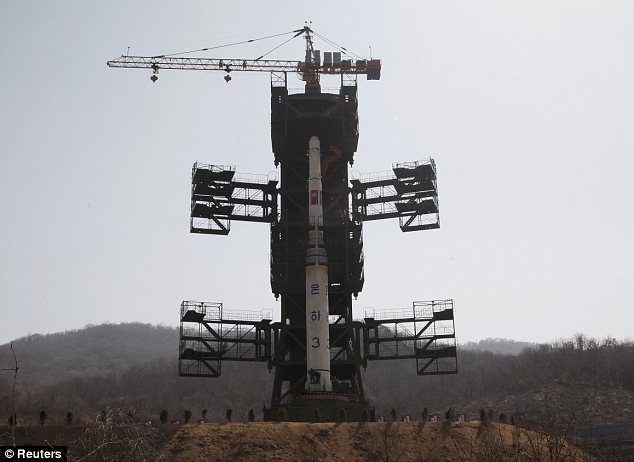 North Korea launches controversial long-range rocket but it blows up 90 SECONDS after take-off