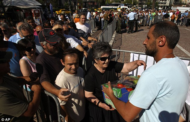 Starving Greeks queue for food in their thousands as debt-wracked country finally forms a coalition government&#8230; but how long will it last?