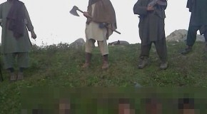 Horrific picture shows armed Taliban militants lording it over 12 decapitated heads of Pakistani 'soldiers'