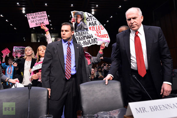 PHOTOS, VIDEO Protesters hold up hearing for Obama's CIA director nominee