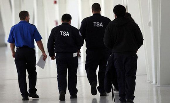 Oops, TSA guy goes spray-zy!
