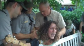 Woman violently arrested for playing banjo in wrong place at Syria war protest in Philly