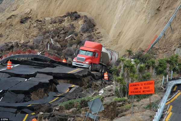 Mexican coastal highway cracks up and slides 300ft down mountainside into sea after earthquake near U.S