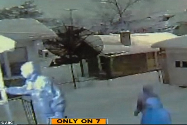CCTV captures moment Detroit mother opens fire on home invaders with rifle