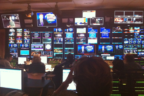 Government monitors in newsrooms: the solution