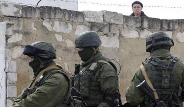 Unidentified gunmen seize military post in Crimea