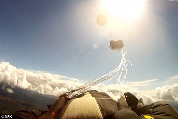 Close call Amazing moment a skydiver is nearly hit by a falling METEORITE just after his parachute opens