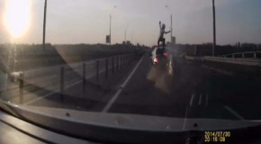 Video: Biker survives rear-ending car by vaulting on to its roof