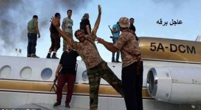 Pictured: Libyan Islamist rebels pose with planes seized from Tripoli airport as U.S. officials warn they could be used to carry out terrorist attack on 9/11 anniversary