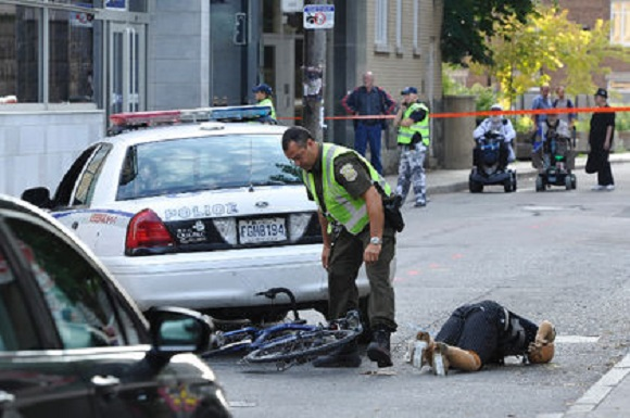 Video Cops Ran Over Cyclist Twice, Arrested Him As He Lay Dying