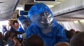 """Airline Passenger Sneezes; """"I have ebola, you are all screwed"""". Airplane Raided By Blue-Suited Ebola Hunters"""