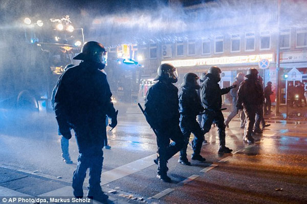 Now ISIS clashes spread across Europe Riot police separate hundreds of Kurds and Islamist supporters in Germany after at least nine are killed in protests in Turkey