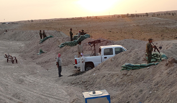 'Women and children dumped in a well' ISIS massacres 322 Sunni tribesmen in west Iraq