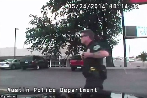 'Go ahead call the cops - they can't un-rape you' Dash cam records two Texas police officers joking about raping a woman walking by their car