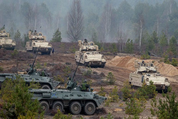 NATO Justifies Military Buildup