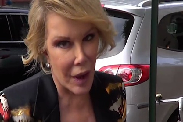 Joan Rivers Reemerging After faking Death, PROVES Michelle Obama is a Man